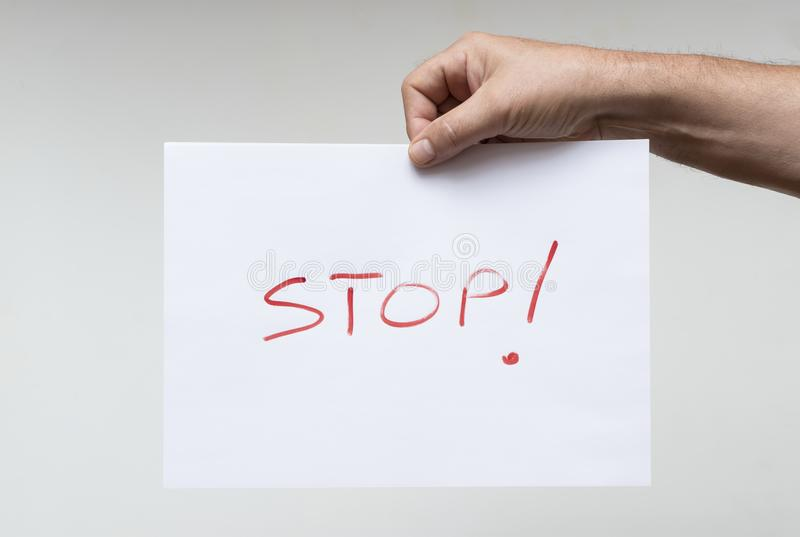 The word Stop. On a white sheet of paper stock photography