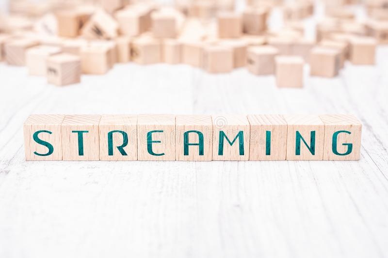 The Word Streaming Formed By Wooden Blocks On A White Table stock images
