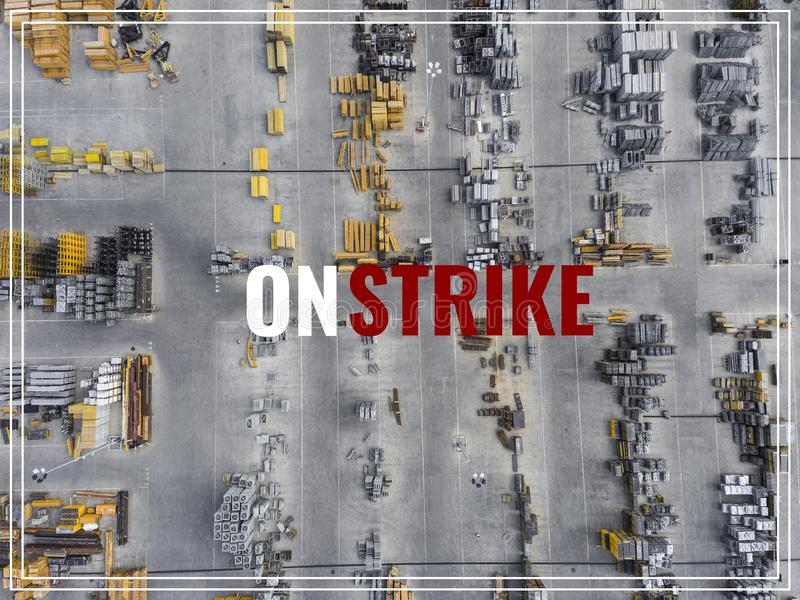 Word Strike Action. Industrial storage place, view from above. stock photo