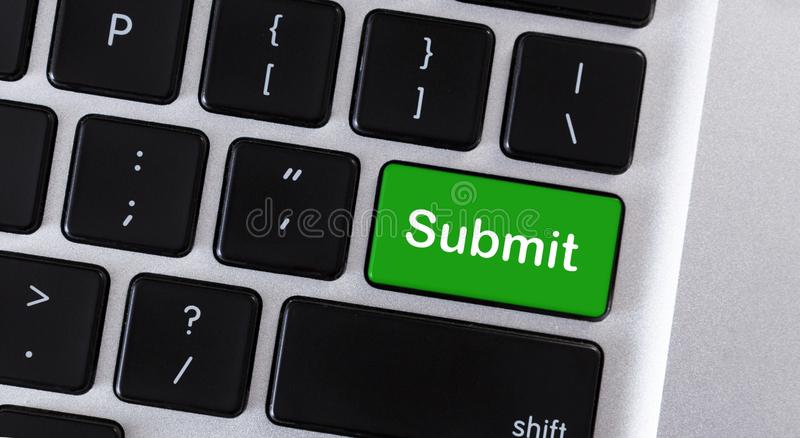 Word Submit on green button of keypad. Word Submit on green button of computer keypad royalty free stock photography