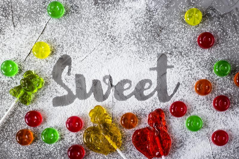 The word sweet is written with powdered sugar royalty free stock photo