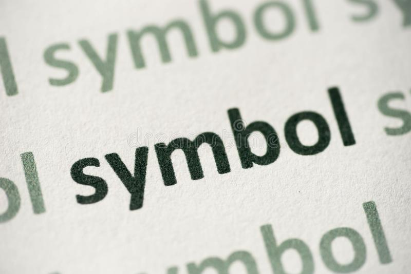 Word symbol printed on paper macro royalty free stock photography