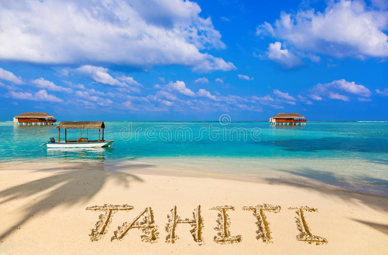 Word Tahiti on beach. Concept holiday background royalty free stock photo