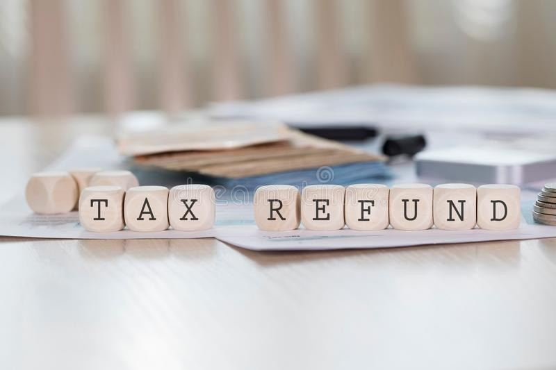 Word TAX REFUND is composed of wooden letters. Closeup royalty free stock photo