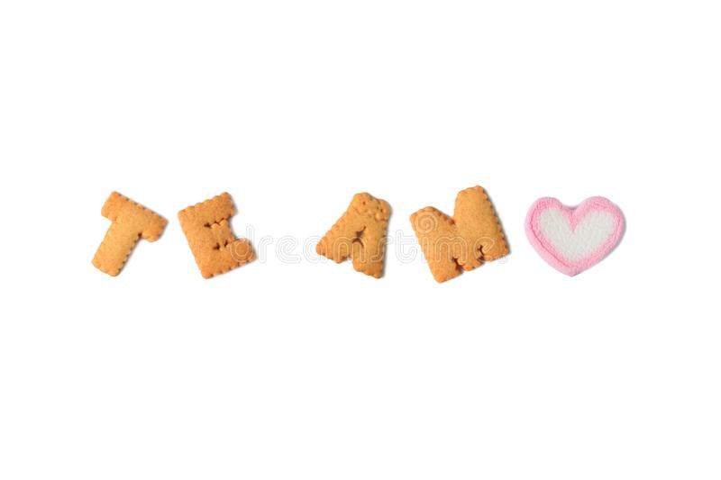 The word TE AMO Meaning I LOVE YOU in Spanish spelled with alphabet shaped biscuits and a heart shaped marshmallow candy royalty free stock images