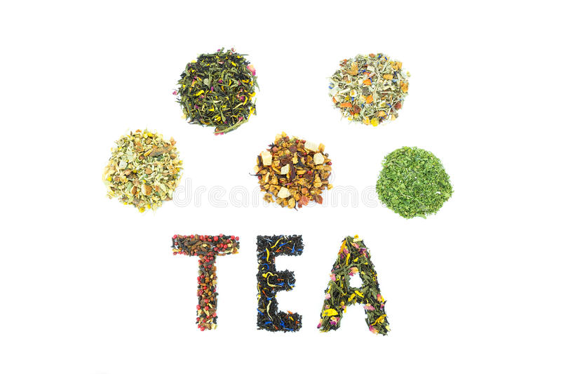 Word TEA with assortment of tea species royalty free stock photography