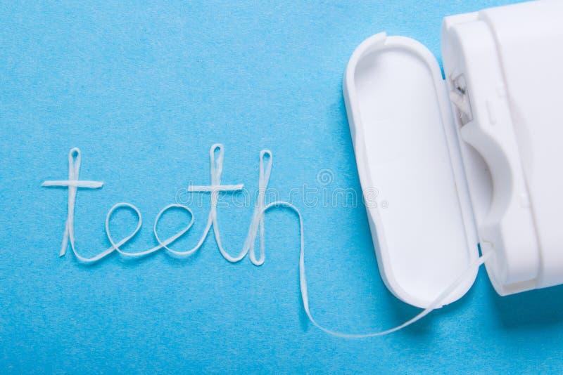 Word teeth of dental floss royalty free stock photo