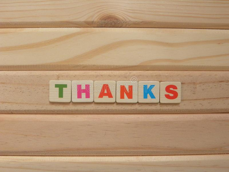 Word Thanks on wood. Background royalty free stock photography