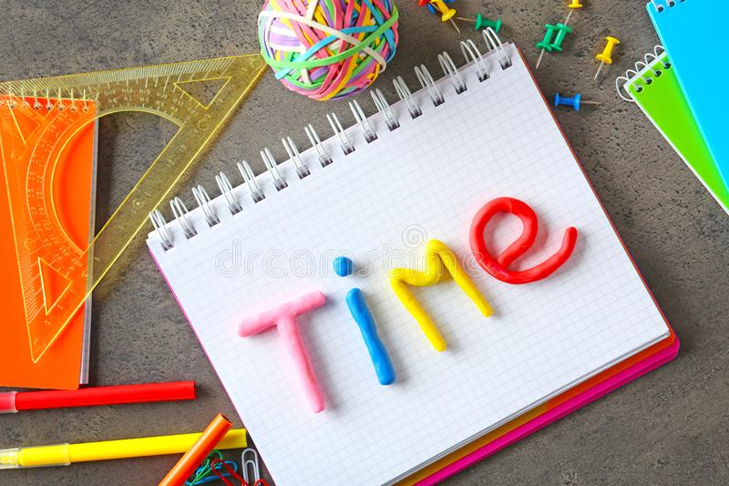Word TIME made of color plasticine on notebook stock photography