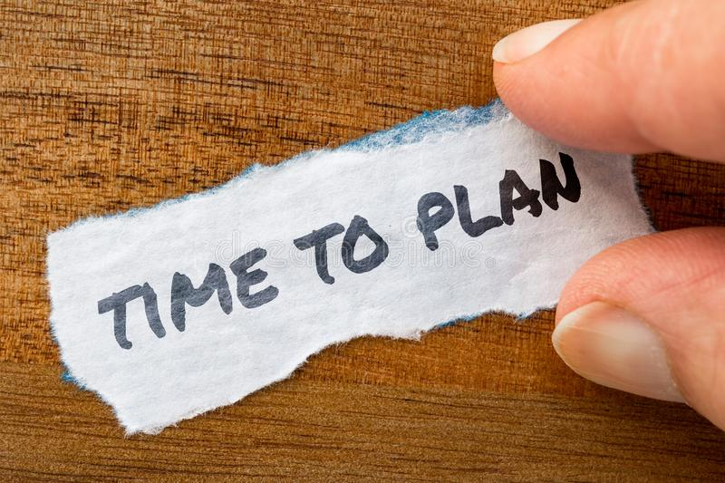 Time to plan concept and theme written on old paper on a grunge background royalty free stock photo