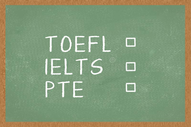 Word TOEFL, IELTS, PTE , with boxes to tick on green Chalkboard background. Test of English as a Foreign Language exams.  stock photos