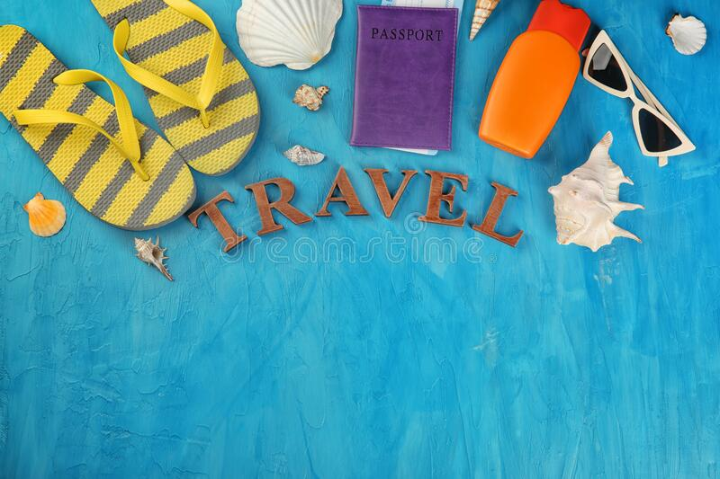 Word TRAVEL made of letters and tourist's stuff on color background, top view royalty free stock images