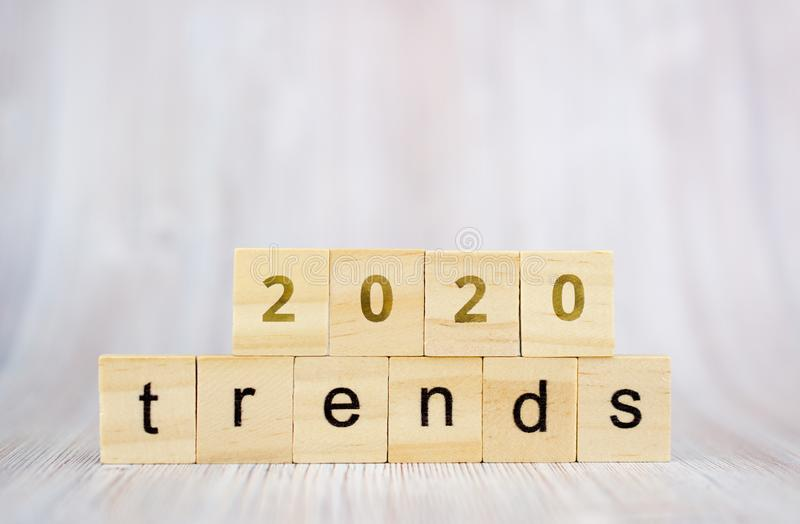 The word trends and 2020 on wooden cube block. 2020 trend concept.  royalty free stock photo