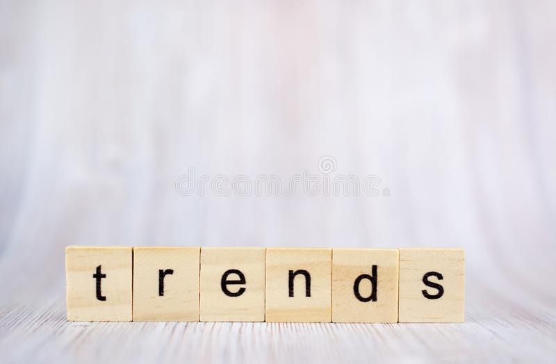 The word trends on wooden cube block. Trend concept.  royalty free stock photo