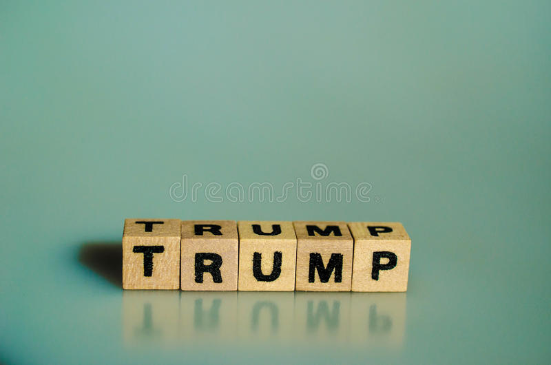 The word Trump written in cubes. On a blue background royalty free stock photos