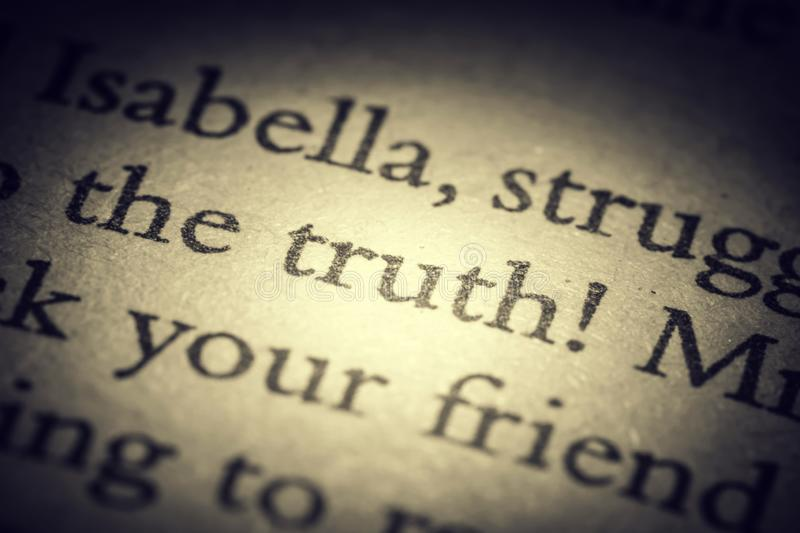 The word truth on old page in a open book close-up macro. Vintage, grunge, old, retro style photo vector illustration