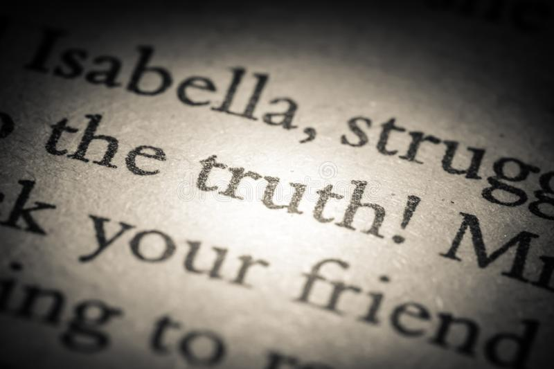 The word truth on old page in a open book close-up macro. Vintage, grunge, old, retro style photo royalty free stock image