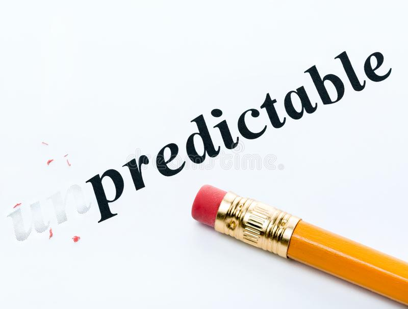 Word unpredictable and predictable with eraser stock photography