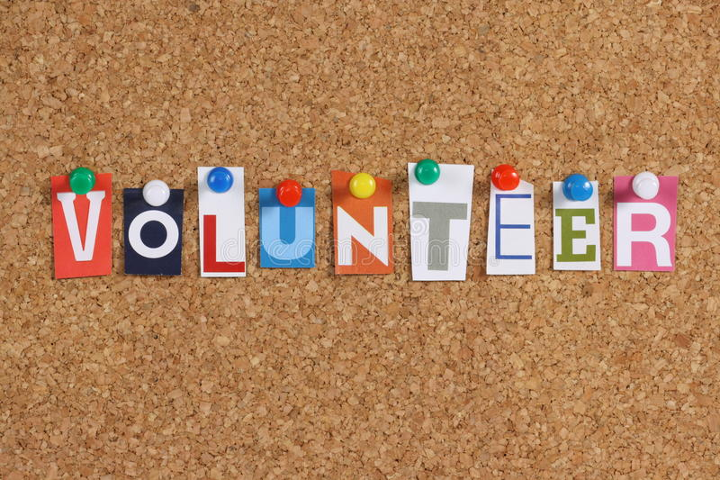 The word Volunteer. In cut out magazine letters pinned to a cork notice board