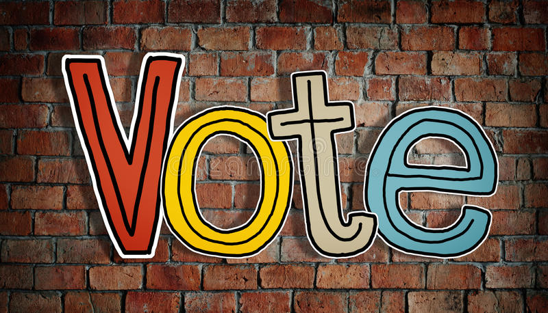 The Word Vote on a Brick Wall stock photography