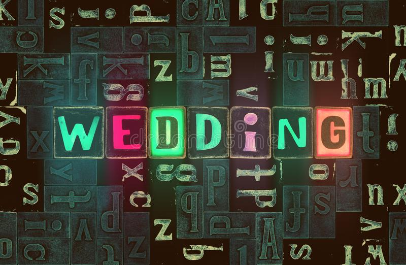 The word Wedding as neon glowing unique typeset symbols, luminous letters wedding. The word wedding with neon luminous glowing, unique typeset letters abstract stock illustration