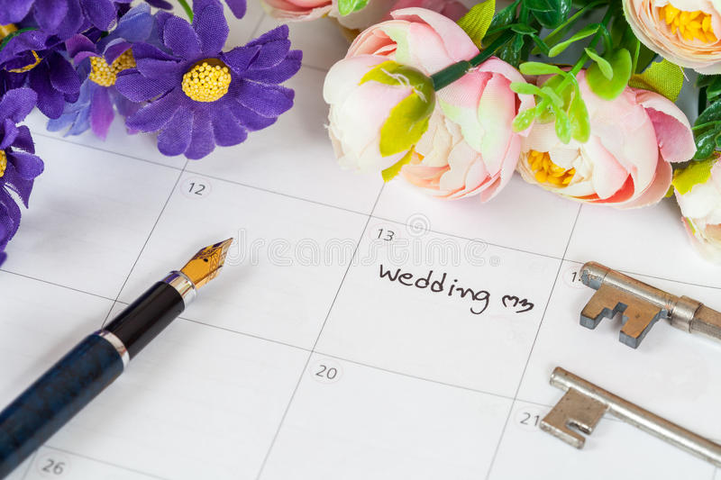 Word wedding on calendar with sweet flowers royalty free stock photography