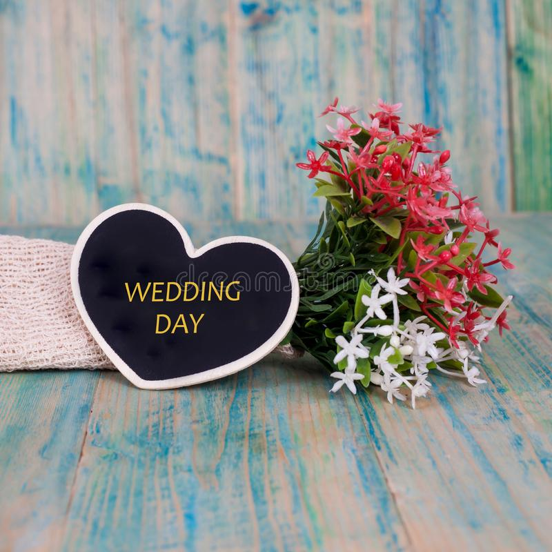 Word wedding day on heart tag with wood stock photography