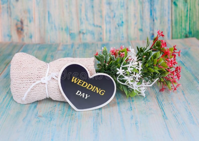 Word wedding day on heart tag with wood stock image