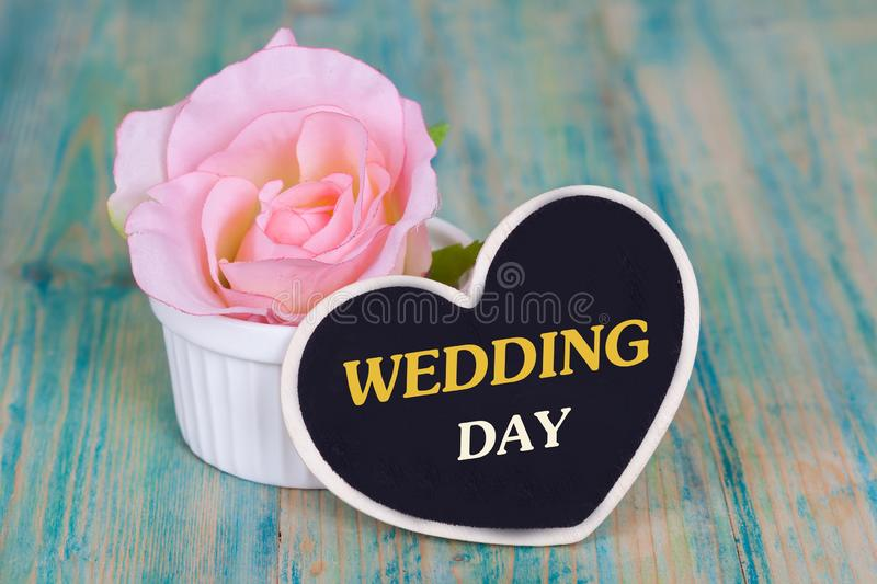 Word wedding day on heart tag with wood royalty free stock photos