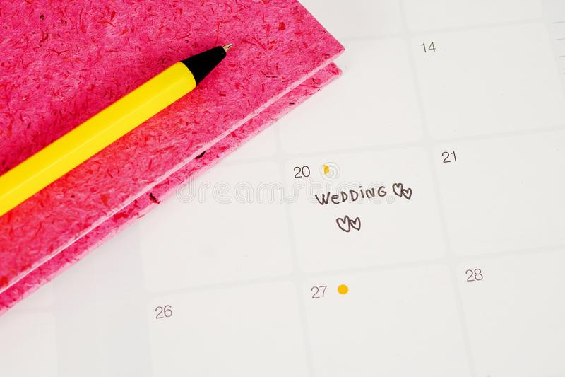 Word Wedding to Reminder Wedding day in calendar planning and pen. With heart royalty free stock images