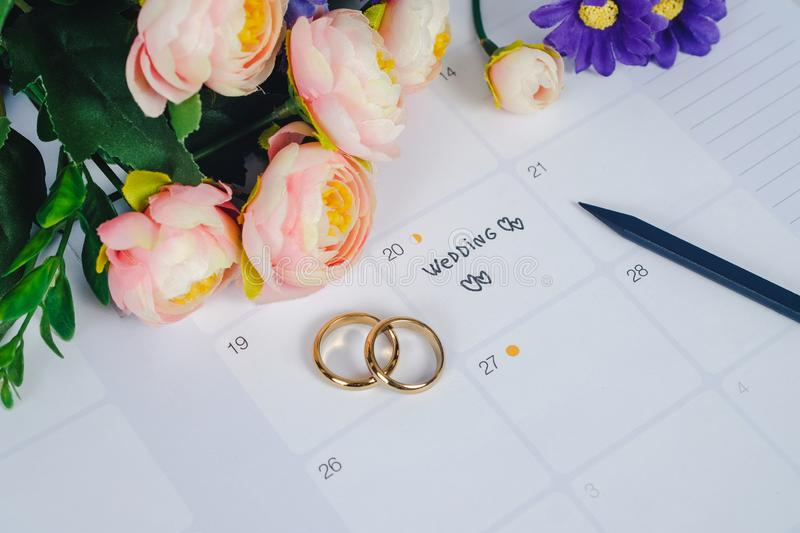 Word Wedding to Reminder Wedding day with Wedding ring on calendar planning. And office tool stock image