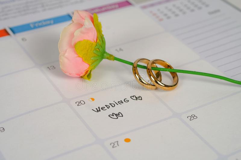Word Wedding to Reminder Wedding day with Wedding ring on calendar planning. And office tool royalty free stock images
