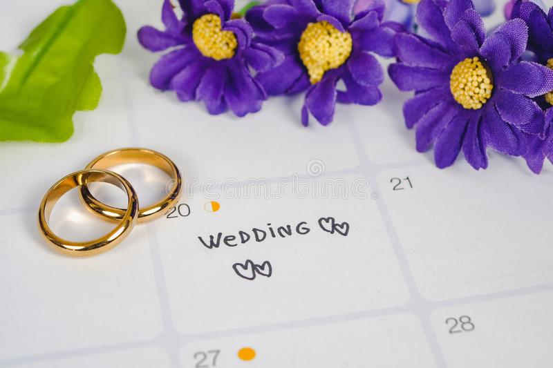 Word Wedding to Reminder Wedding day with Wedding ring on calendar planning and office tool royalty free stock image