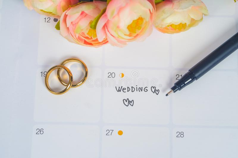 Word Wedding to Reminder Wedding day with Wedding ring on calendar planning royalty free stock images
