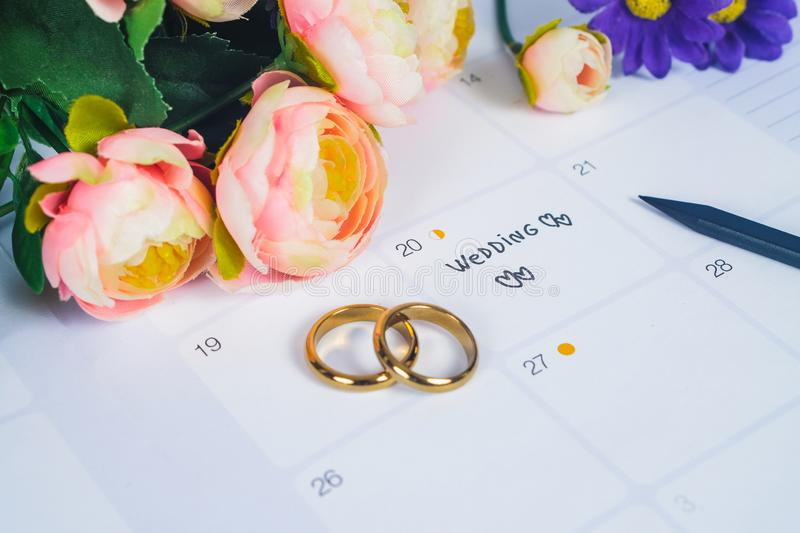 Word Wedding to Reminder Wedding day with Wedding ring on calendar planning stock image