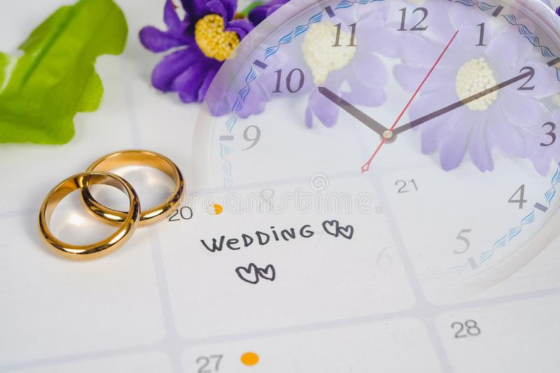 Word Wedding to Reminder Wedding day with Wedding ring on calendar planning royalty free stock photo