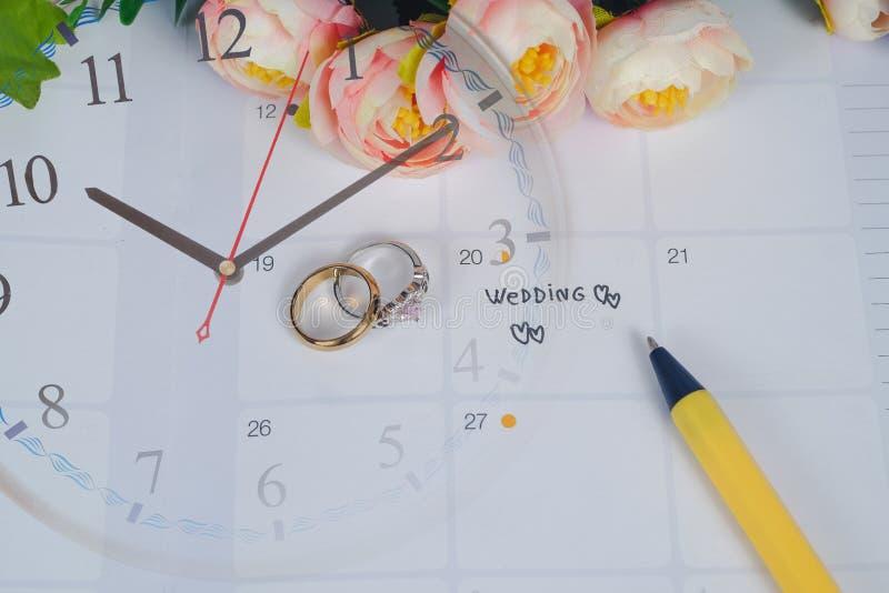Word Wedding to Reminder Wedding day with Wedding ring on calendar planning stock image