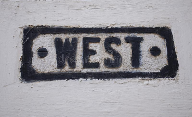 Word west on the wall. Giving a stalwart look. Background royalty free stock photography