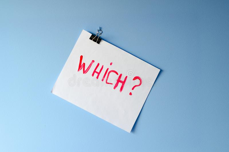 The word Which? painted on white paper sheet. Asking for help in solving a mystery and finding a reason for overwhelming stress and anxiety royalty free stock photography