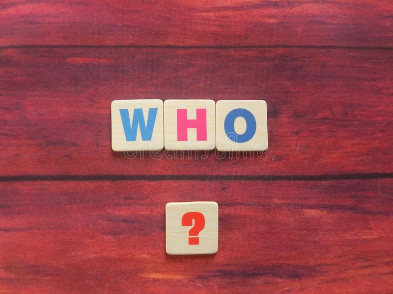 Word Who on wood. Word Who with question mark ? on wood background stock photos