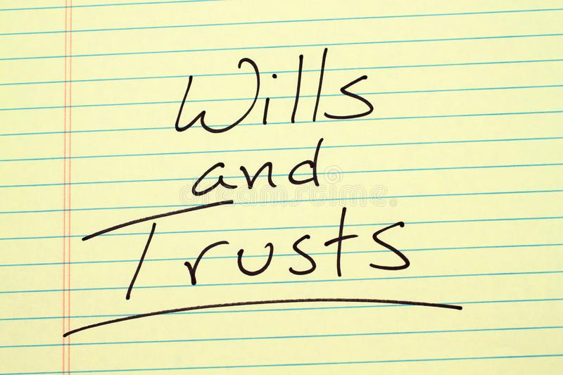Wills and trusts on a yellow legal pad. The word `Wills and Trusts` underlined on a yellow legal pad royalty free stock photos