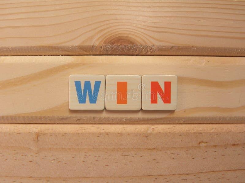 Word Win op hout royalty-vrije stock fotografie