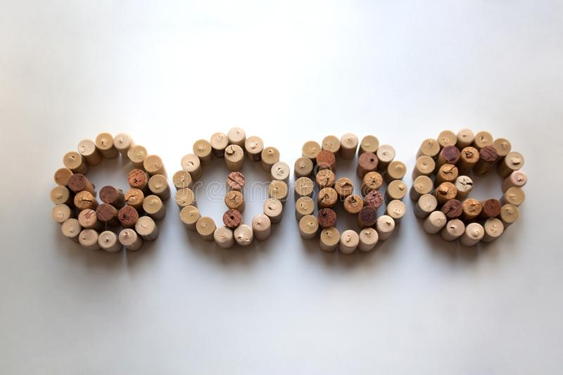 Word `wine` with circled letters made of corks stock images