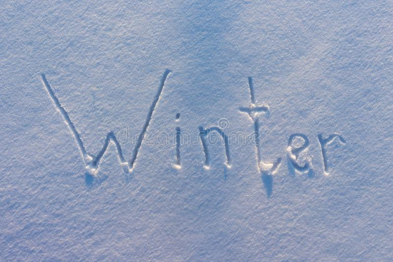 The word Winter written on snow royalty free stock images