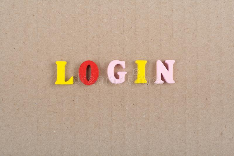 LOGIN word on wooden background composed from colorful abc alphabet block wooden letters, copy space for ad text. Word on wooden background composed from stock image