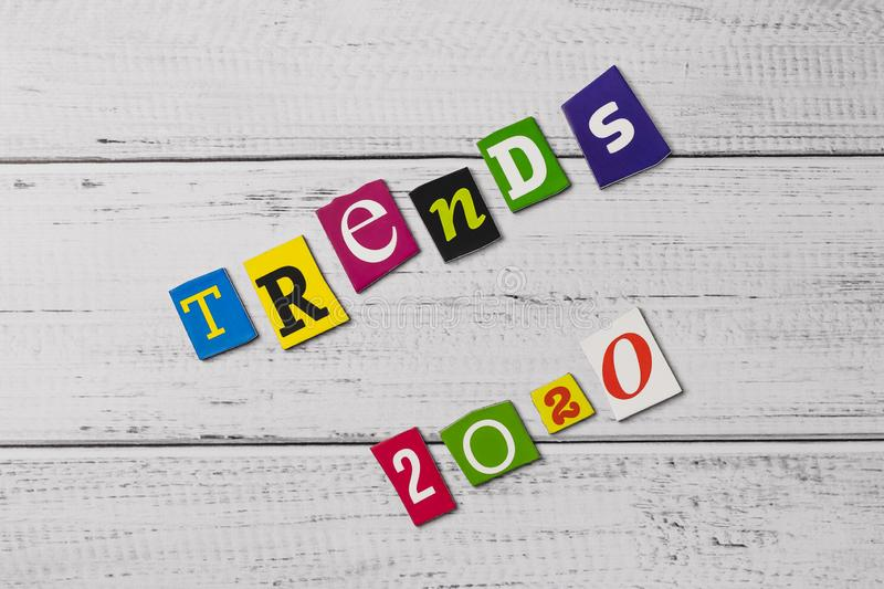 Word on wooden board. Trends - 2020. Cut colorful letters. Card, banner with inscription. Text message. The multicolor words on wo stock images