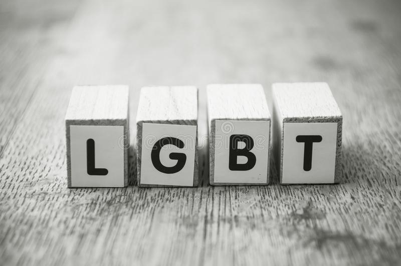 word on wooden cube on wooden desk background concept - LGBT stock photo