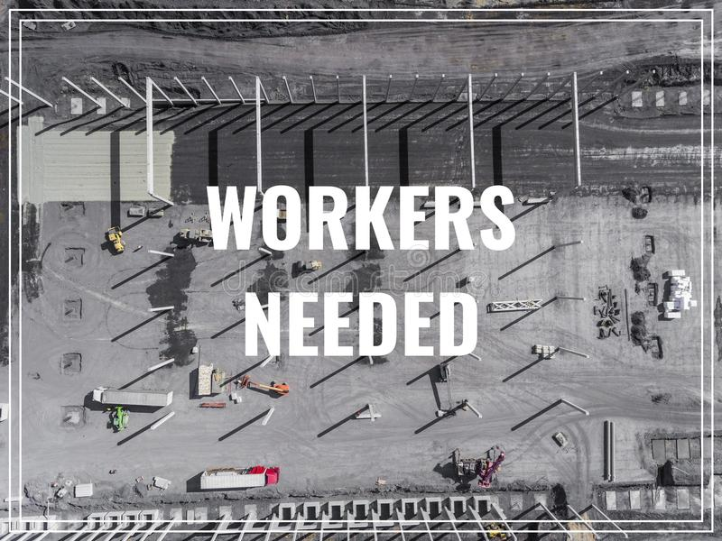 Word Workers Needed over industrial place from above. royalty free stock photos