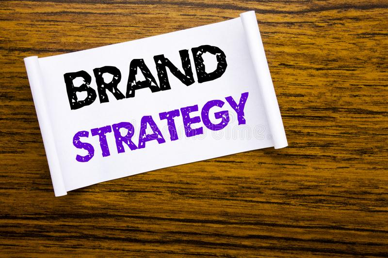 Word, writing Brand Strategy. Business concept for Marketing Idea Plan written on sticky note paper on the wooden wood structure v. Word, writing Brand Strategy royalty free stock photography