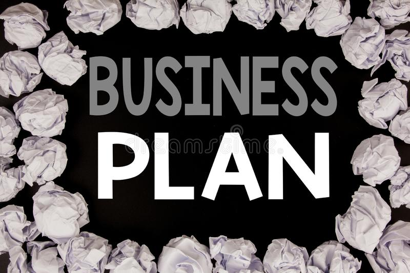 Word, writing Business Plan Planning. Business concept for Preparation Project Strategy written on black background with copy spac. E on background with folded stock photo